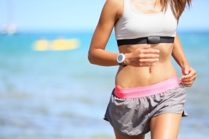 Bigstock-21109267-Runner-woman-with-heart-rate-monitor-running-on-beach-with-watch-and-sports-bra-top
